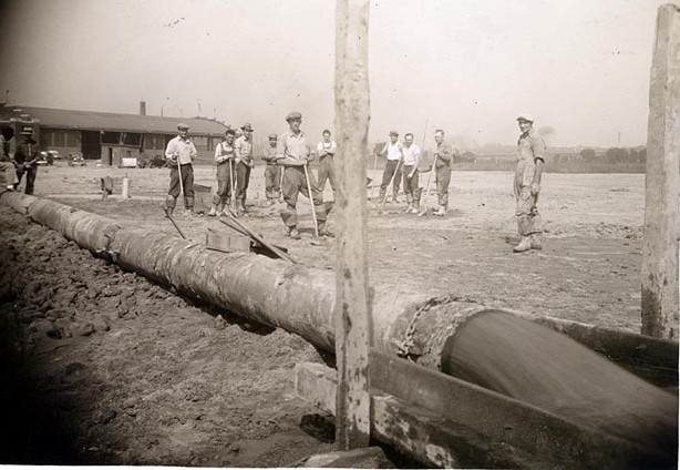 WPA workers take a break during construction at Holman Field about 1940. This is likely part of the filling in of Lamprey Lake to create more space for the airport.