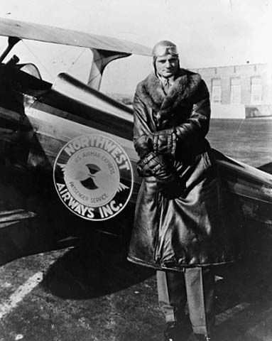 """Holman Field is named in honor of Charles W. """"Speed"""" Holman, famed pilot who died when his plane crashed during an Omaha, NE airshow in 1931. Holman, a Bloomington native, flew air mail planes for Northwest Airlines and worked as the airline's operations manager. Holman is standing in front of his mail plane about 1930. Minnesota Historical Society"""