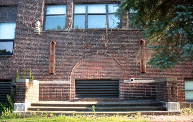 Although callously bricked up and used to vent some equipment, the original entrance to Murray remains recognizable.