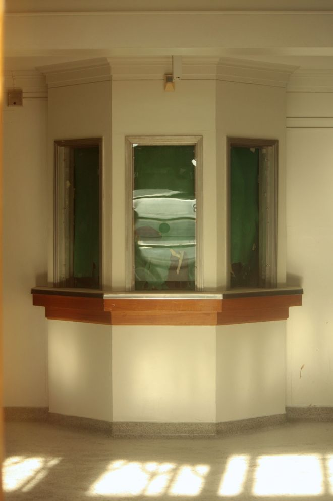 Gazing through the windows of the auditorium entrance, the box office seems to be nearly unchanged from when it was constructed.