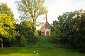 A couple enjoying a picnic. Rising behind them, St. Matthew's Episcopal Church, built in 1914.