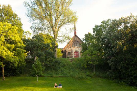 A couple enjoying a picnic. Rising behind them, St. Matthew's Episcopal Church, built in 1914.