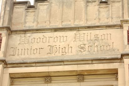 The school sign above the main entrance on  Street.