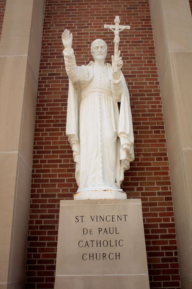 The statue of St. Vincent de Paul, the Patron Saint of charitable societies, watches over those who pass by on