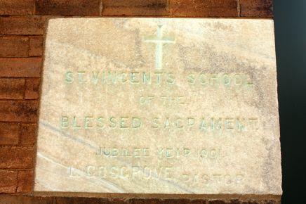 The fading cornerstone of the former St. Vincent's School.
