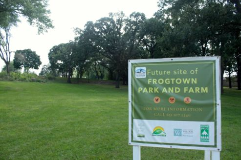 This park sign is on the northern-most border along Minnehaha Avenue. The meadow seen in earlier shots of Frogtown Park is beyond the trees on the left side of the picture.