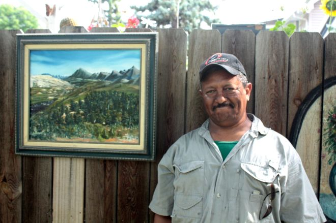 "David Wald poses with his interpretation of Hot Springs in Wyoming, which he calls, ""the most beautiful sight ever."""