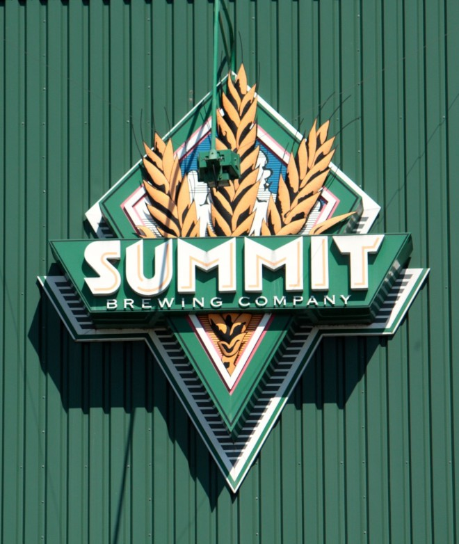 The large Summit logo on the side of the brewery.