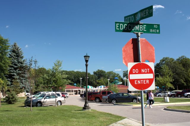 Highland Park Aquatic Center sits on Otto Hummer Drive, a street that looks like a parking lot.