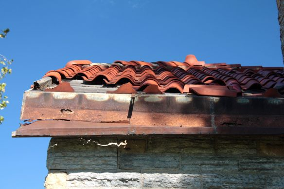 You can see the subroof and missing clay tiles.