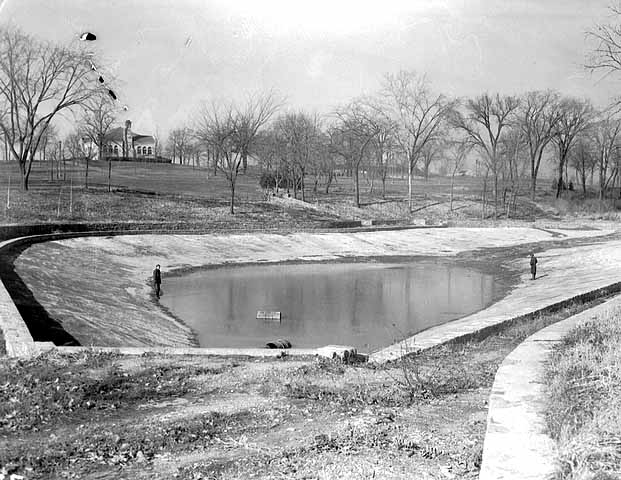 This is what the original Highland Park Pool looked like in 1935. The building in the background is the golf clubhouse, which still stands. Courtesy Minnesota Historical Society.