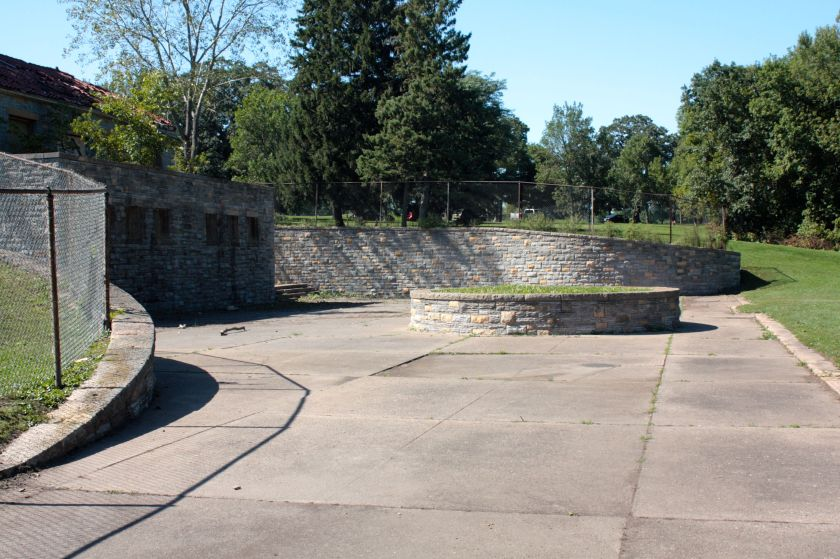 The back or pool side of the bath house. The pool was situated about where the grass is on the right. The round stone structure in the middle of the picture held a large tree.