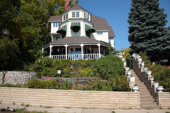 Perched over Ramsey Street like a royal overlooking her subjects, 319 is known today as the Arth House. According to myresearch, at least one law firm is located here. A wrap-around porch and three-sided area in the center-front of the house vie for the attention of passers by.
