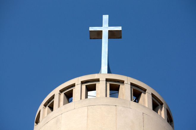 The cross atop the spire at Saint Columba.