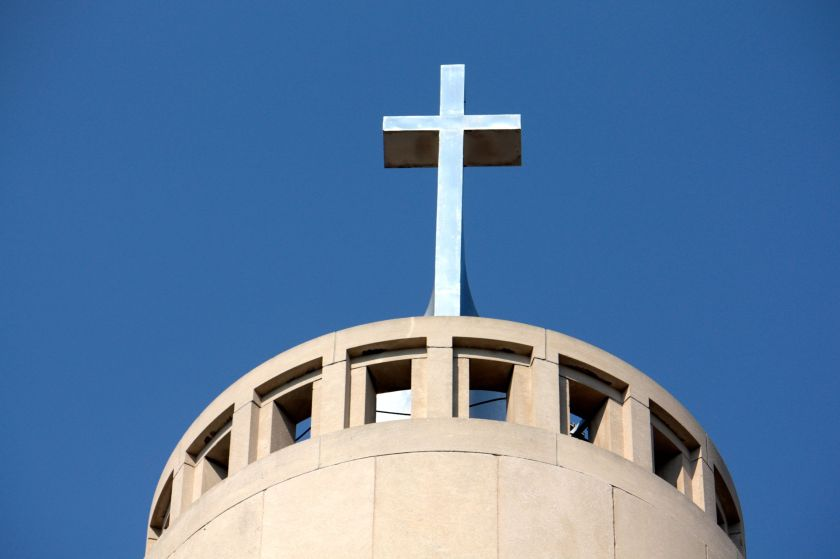 The cross atop the spire at Saint Columba.