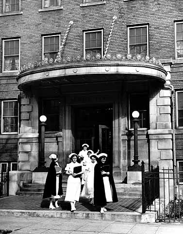 Nurses gathered outside their dorm in 1953.