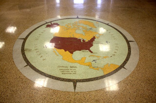 The terrazzo map of North America is the interior showpiece of the Saint Paul Downtown Airport terminal building.
