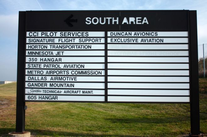 A sign shows of some of the tenants oin the southern part of the airport. Intriguingly, many tenants are not listed on this register and buildings and hangers lack any identification other than the address.