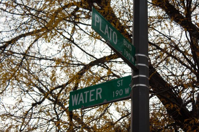 The signpost at the corner of Water Street and Plato Boulevard.