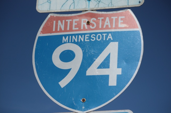 """The Interstate 94 sign on Cleveland and Wabash Avenues. Older signs like this one have the name of the state between the word """"Interstate"""" and the number. Newer signs are generic, no longer carrying the state in which they sit."""
