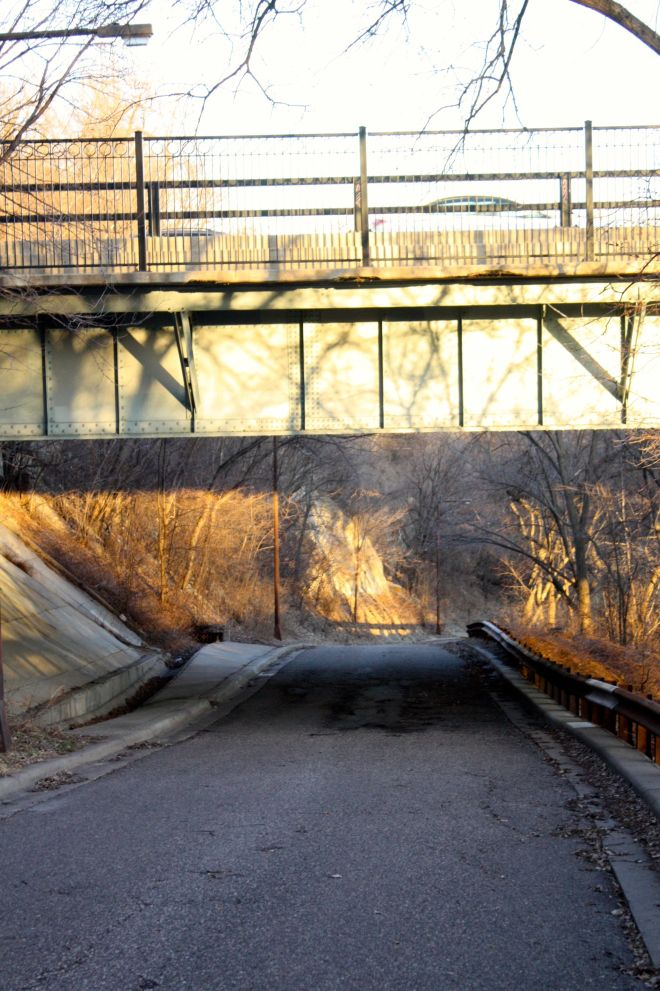 Lower Hidden Falls Drive dips out of sight. Above, the Highway 5 bridge over the Mississippi River .