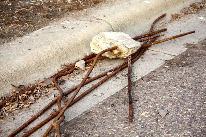 Metal rebar and a section of concrete that dropped from the underside of the Highway 5 bridge.