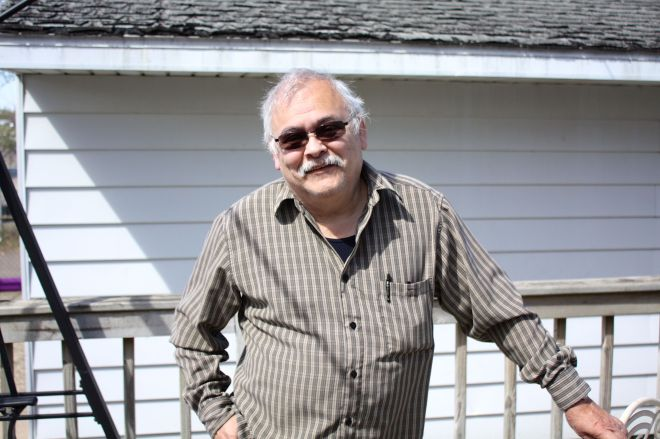 George Rodriguez stands on the deck between his house and garage at 833 Burr Street.