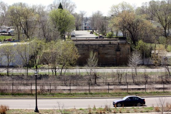 """Before construction of Phalen Boulevard (foreground), Burr Street went continued over the railroad tracks and industrial corridor. According to George, """"It's nice and quiet now actually compared to what it was then (before Phalen)."""""""