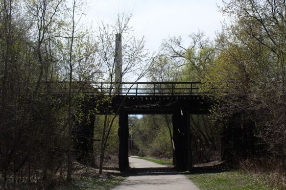 Looking south along Swede Hollow Park's hiking and biking trail. The smoke stack on the left is part of the former Hamm's Brewery.