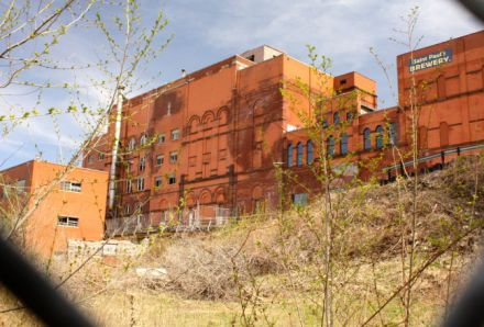 Several of the former brewery buildings are being put to new uses. The two on the right are part of the Flat Earth Brewery, which relocated more than a year ago from a small facility in Highland Park. I took the picture through the cyclone fence along the west side of the property.