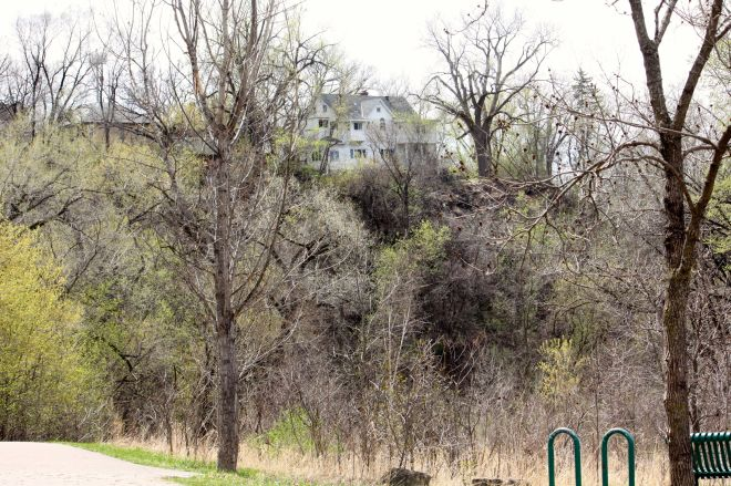 Most likely, the house on the bluff far above Swede Hollow is on East North Street.