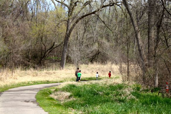 A family walks north along one of the paths in Swede Hollow Park. Leaves are popping on one tree and the reeds and some grass are greening up nicely. In no way does Swede Hollow of today resemble that of where George Rodriguez and his family lived 60 years ago.