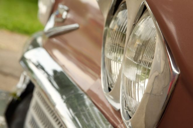 The dual headlights and toothy chrome grill of the classic 1958 Chevy.