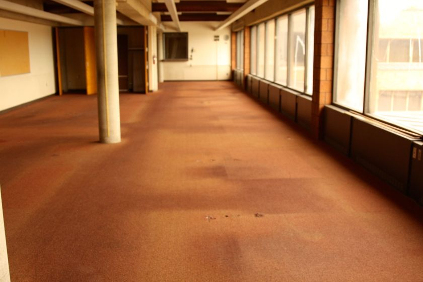 Even empty, marks on the carpet clearly show a cube farm once sat here.