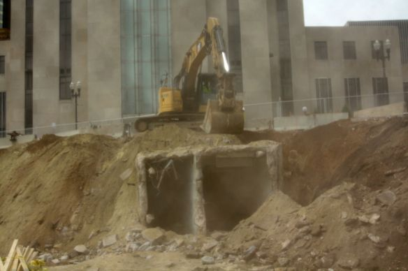 The two tunnels between the courthouse and the former jail are partially exposed because of the demolition. Prisoners were always escorted by deputies through the tunnel to the right. The public, including family members and attorneys, came to the jail from the courthouse via the left tunnel.