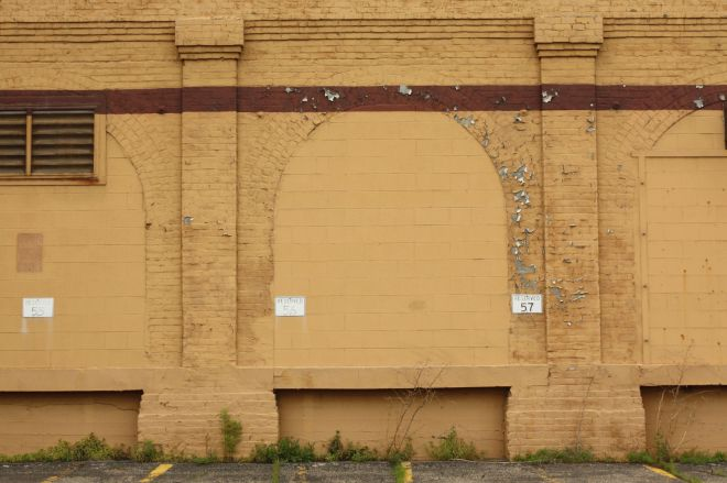 These arches haven't always been sealed with bricks. Were they loading docks to move ink, paper and other supplies into and finished law books out of the plant?