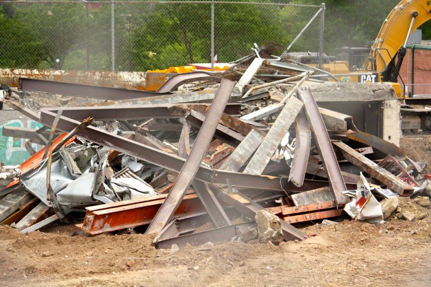 Girders from the store are piled to the side in preparation for recycling.