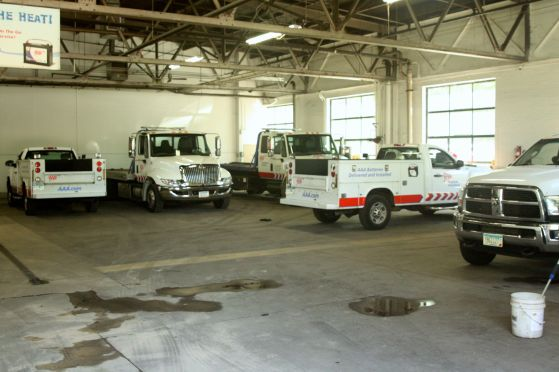 Several Triple-A vehicles remain in the garage, awaiting a call, on this fine summer day.