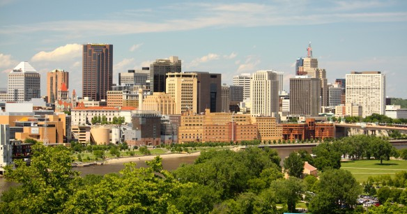 Among the buildings along the skyline (left to right) are: the 37 story Wells Fargo Place; Saint Paul City Hall/Ramsey County Courthouse; three Century Link buildings; the former Ramsey County Jail and Government Center East; Crown Plaza Hotel; First National Bank Building and Kellogg Square.