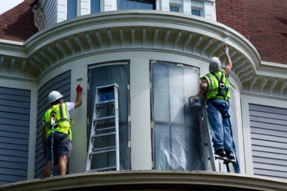 Due to the height workers wore safety harnesses while working on the second and third stories.