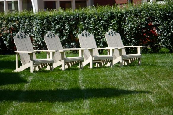 Across Summit Avenue from the Bishop House, these four Adirondack chairs wear their address numbers, perhaps to deter thieves.