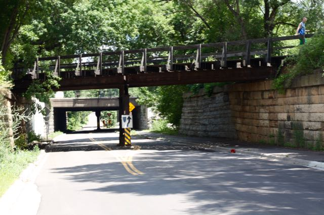 In the foreground, a former railroad bridge is now the Bruce Vento Regional Trail for biking and hiking. The bridge in the background carries the very heavily used Burlington Northern Santa Fe tracks.