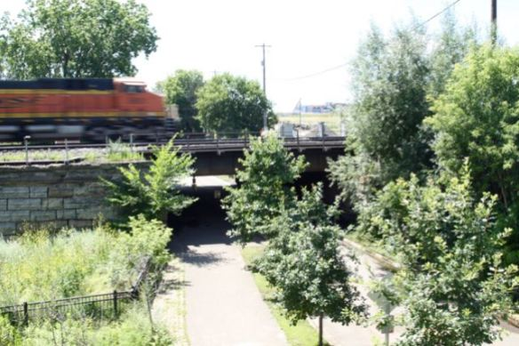 One of many BNSF freight trains that pass by daily speeds over 4th Street East on its way north.