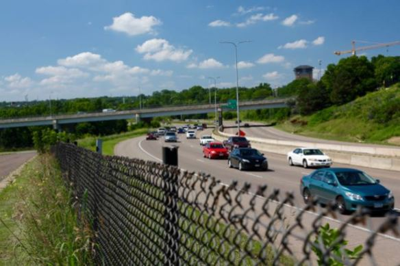 I-94 (right) passes within a dozen yards of Commercial Street, the sliver of asphalt on the left. The cacophony of vehicles rushing past at 60 miles per hour or more is ear-piercing.