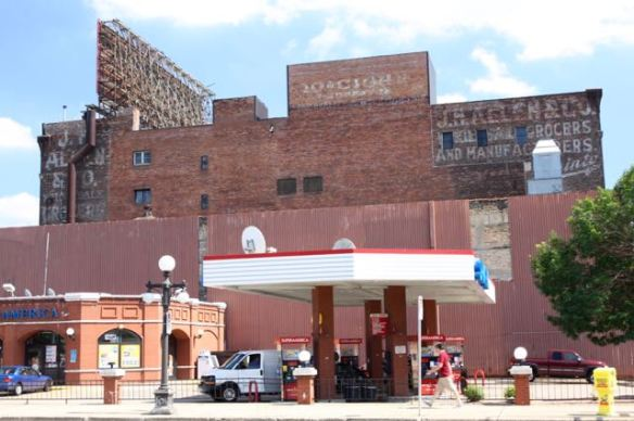 The brick exterior of the gas station fits with the neighborhood about as well as you can hope. The