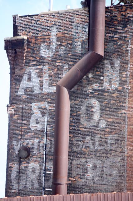 Another J.H. Allen sign decorates the other side of the north-facing wall.
