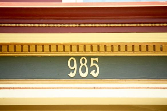 The unusual style of the address numbers complements the colors above the front entrance.