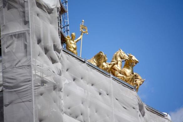The Quadriga peaks over the protective covering.