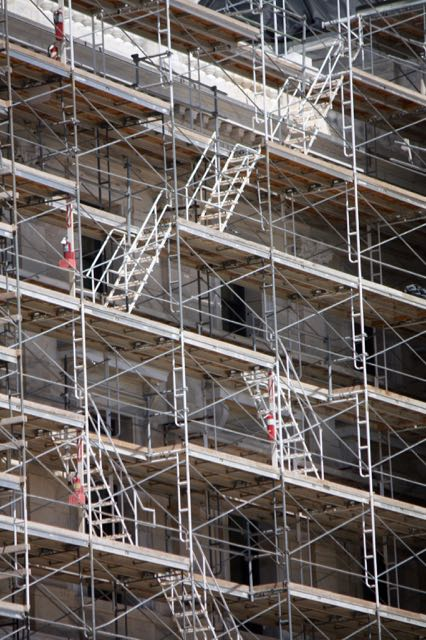 The scaffolding and stairs create a maze-like look.