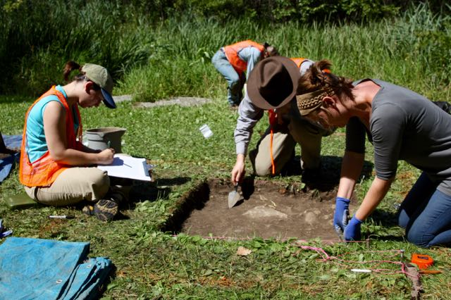 Volunteers assist University of Minnesota Archaeology students at one of two dig sites within Swede Hollow.